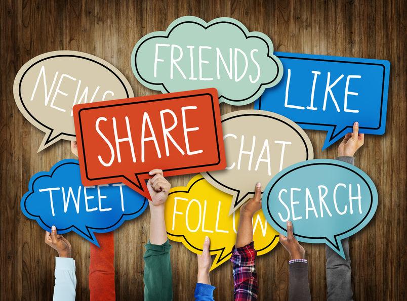 social media ideas: 34537384 - hands holding speech bubbles with social media words